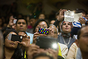 Parents record and photograph their children on their mobile devices during the Milpitas Unified School District's 11th Annual Music Festival at Milpitas High School in Milpitas, California, on April 10, 2014. (Stan Olszewski/SOSKIphoto)