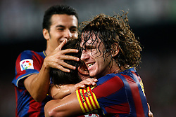FC Barcelona's Carlos Puyol (r), Bojan Krkic (c) and Pedro Rodriguez (l) celebrate goal during La Liga match.August 31 2009.