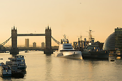 © Licensed to London News Pictures. 08/09/2016. LONDON, UK. A superyacht, known as 'Motor Yacht A' is seen moored next to HMS Belfast on the River Thames during the morning light. Motor Yacht A is owned by Russian billionaire, Andrey Melnichenko (known as the King of Bling). The stunning 390ft super yacht design is inspired by a submarine and was designed by Philippe Starck. It has been reported that Melnichenko is currently building a new super yacht and Motor Yacht A will be put up for sale.<br /> Photo credit: Vickie Flores/LNP