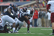 Mississippi linebacker Denzel Nkemdiche (4) tackles Troy running back Brandon Burks (32) at Vaught-Hemingway Stadium in Oxford, Miss. on Saturday, November 16, 2013. Ole Miss won 51-21.