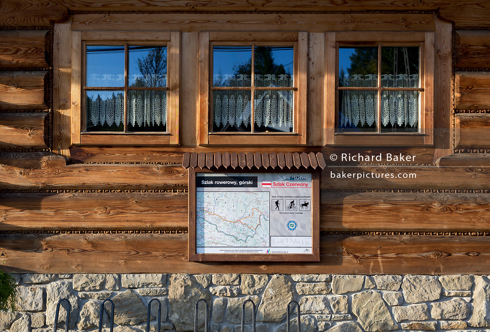 A hiking trail map outside the Bocowka restaurant, a traditional mountain log cabin in southern Poland, on 21st September 2019, in Jaworki, near Szczawnica, Malopolska, Poland.