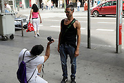 male person being photographed in the street