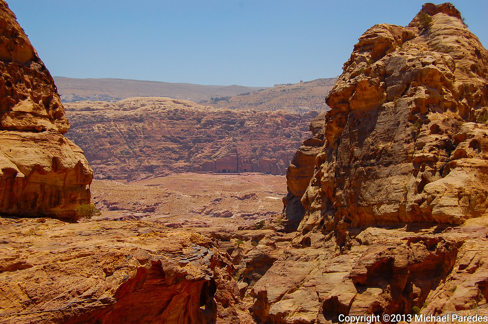 Ancient tombs can be seen beyond the red rocks in the nearly 2000 year old city of Petra, Jordan