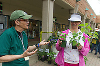 "The Hyde Park Shopping Center hosted its annual Garden Fair this weekend attracting many from all over Chicago.<br /> <br /> 8924 – Loise Mcurry and Blanche Roberts talk about plants at the Garden Fair.<br /> <br /> Please 'Like' ""Spencer Bibbs Photography"" on Facebook.<br /> <br /> All rights to this photo are owned by Spencer Bibbs of Spencer Bibbs Photography and may only be used in any way shape or form, whole or in part with written permission by the owner of the photo, Spencer Bibbs.<br /> <br /> For all of your photography needs, please contact Spencer Bibbs at 773-895-4744. I can also be reached in the following ways:<br /> <br /> Website – www.spbdigitalconcepts.photoshelter.com<br /> <br /> Text - Text ""Spencer Bibbs"" to 72727<br /> <br /> Email – spencerbibbsphotography@yahoo.com"