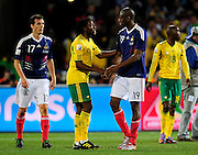 French players exchange handshakes with South African players at the end of  the 2010 World Cup Soccer match between South Africa and France played at the Freestate Stadium in Bloemfontein South Africa on 22 June 2010.  Photo: Gerhard Steenkamp/Cleva Media