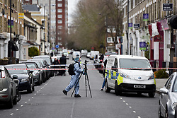 © Licensed to London News Pictures. 31/12/2018. West London, UK. Forensic photographer at the entrance to a property believed to have hosted a party linked to an attempted murder and mass arrest. A man in his 30s was left fighting for his life after being stabbed on Fulham Palace Road in an unprovoked attack in the early hours of New Years Eve. Police have arrested 39 individuals at a party at a near by address where the assailant ran to following the attack according to eye witnesses. Photo credit Guilhem Baker/LNP