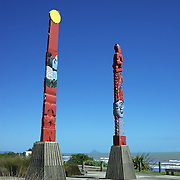 "Te Ara Ki Te Rawhiti. Waiotahi Beach. New Zealand. ""Te Ara Ki Te Rawhiti"" The Pathway to the Sunrise, these pouwhenua or pou, carved pillars, stand side by side beside the beach at Waiotahi, on the coast road to Opotiki, facing the direction of the first sunrise of the world's new day. Waiotahi Beach, New Zealand. 20th January  2010. Photo Tim Clayton.."