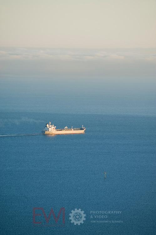 Oil Tanker sailing toward fog bank in Port Phillip Bay, Australia
