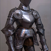 Close up of sixteenth century etched steel armor for man in the Arms an Armor Gallery in The Metropolitan Museum of Art (MET) New York City.