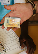 Angolan citizen presents his voter card in order to exercise their right to vote in the general elections of 2012, today August 31