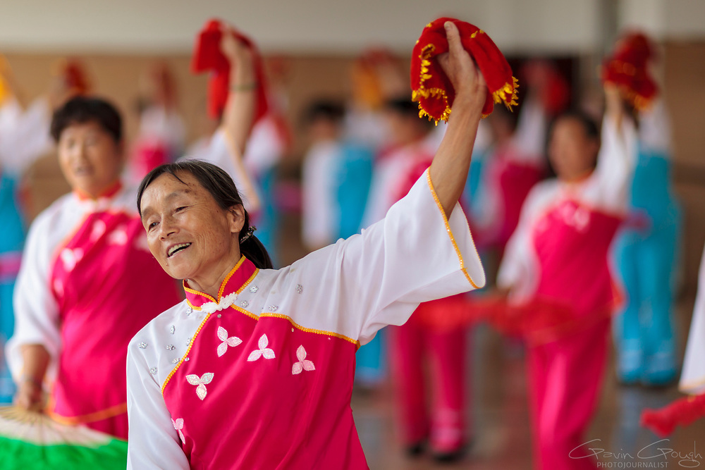 Students rehearse a traditional Chinese dance performance at a University of the Third Age (U3A).