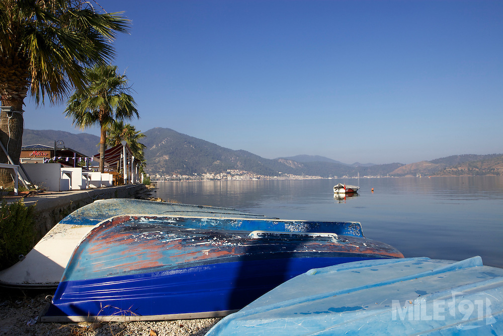 Upside down hulls of rowing boats on the shore, Fethiye, Turkey.