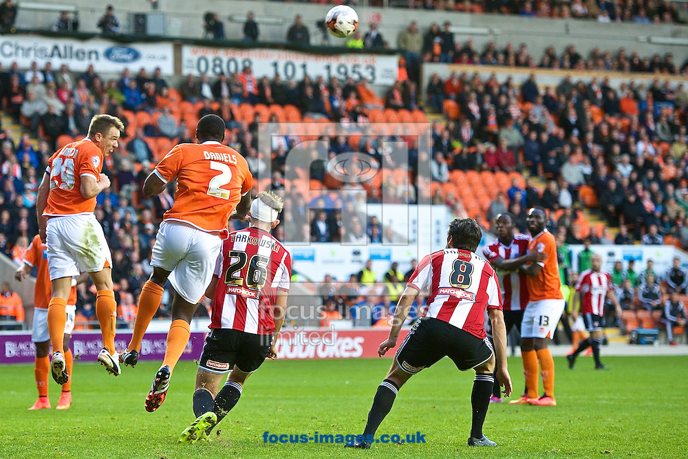 Anthony McMahon of Blackpool heads clear during the Sky Bet Championship match at Bloomfield Road, Blackpool<br /> Picture by Ian Wadkins/Focus Images Ltd +44 7877 568959<br /> 19/08/2014