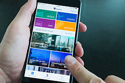 Detail of Expedia travel booking app on iPhone 6 Plus smart Phone