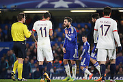 Chelsea midfielder Cesc Fabregas (4) protesting his innocence to the ref during the Champions League match between Chelsea and Paris Saint-Germain at Stamford Bridge, London, England on 9 March 2016. Photo by Matthew Redman.