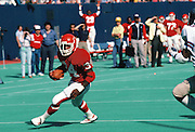 New Jersey Generals running back Herschel Walker (34) runs the ball during the USFL football game against the Michigan Panthers in East Rutherford, N.J. on April 29, 1984. The Generals won the game 31-21. (©Paul Anthony Spinelli)