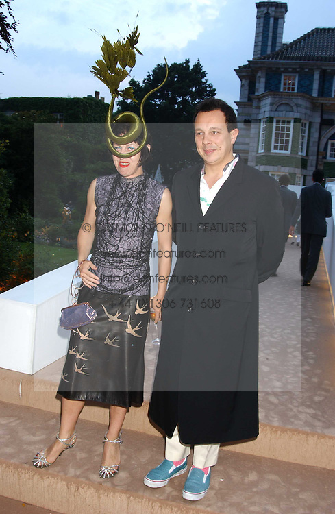 DETMAR &amp; ISABELLA BLOW at a summer party hosted by champagne house Krug held at Debbenham House, 8 Addison Road, London on 28th June 2005.<br />