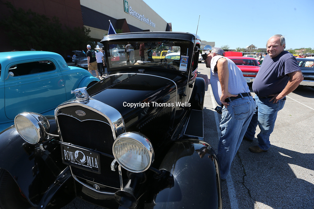 "William McLeroy, left, of New Albany and Forrest Drake of Wheeler take a closer look of 1930 Ford Model ""A"" at Saturday' Blue Suede Cruise. Drake was looking for ideas he can use as restores his own 1929 Model ""A""."