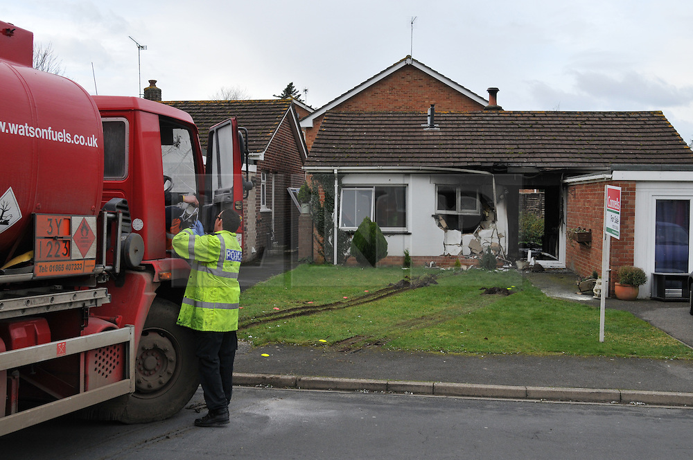 © Licensed to London News Pictures. 20.01.2012. Wool, Dorset. A 51-year-old man has been arrested on suspicion of attempted murder after a fuel tanker has smashed into a bungalow in Dorset and set it ablaze. Around 30 firefighters were called to the blaze, which swept through the house after the tanker smashed through the front windows. Photo credit: Christopher Gretkus/LNP