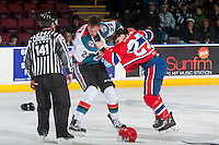 KELOWNA, CANADA - JANUARY 4: Braydyn Chizen #22 of the Kelowna Rockets drops the gloves with Riley McKay #27 of the Spokane Chiefs during first period on January 4, 2017 at Prospera Place in Kelowna, British Columbia, Canada.  (Photo by Marissa Baecker/Shoot the Breeze)  *** Local Caption ***