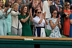 LONDON, ENGLAND - Saturday, July 13, 2019: Catherine Middleton (Duchess of Cambridge), Rachel Meghan Markle (Duchess of Sussex) and Philippa Middleton applaud from the Royal Box as Simona Halep (ROU) wins the Ladies' Singles final match on Day Twelve of The Championships Wimbledon 2019 at the All England Lawn Tennis and Croquet Club. Halep won 6-2, 6-2. (Pic by Kirsten Holst/Propaganda)