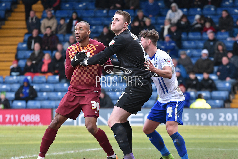 Bury Goalkeeper, Ian Lawlor battles woith Bradford City Forward, Wes Thomas during the Sky Bet League 1 match between Bury and Bradford City at the JD Stadium, Bury, England on 5 March 2016. Photo by Mark Pollitt.