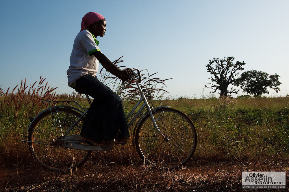 Abdulai Sadia rides a bicycle through the community of Kunayili, near Gushegu, Northern Ghana, on Wednesday November 2, 2011.