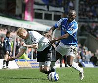 Photo: Lee Earle.<br /> Birmingham City v Chelsea. The Barclays Premiership. 01/04/2006. Chelsea's Damien Duff (L) battles with Olivier Tebily.