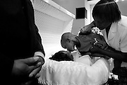 Jajreon Jackson, 3, kisses his grandmother Gloria Jackson good-bye held by Vanessa Simmons at the funeral in McKinney, Texas on May 04, 2005.