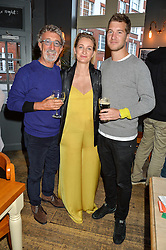 Left to right, EDDIE JORDAN, his daughter ZOE JORDAN and KYLE JORDAN at a quiz night hosted by Zoe Jordan to celebrate the launch of her men's ZJKNITLAB collection held at The Larrick Pub, 32 Crawford Place, London on 20th April 2016.