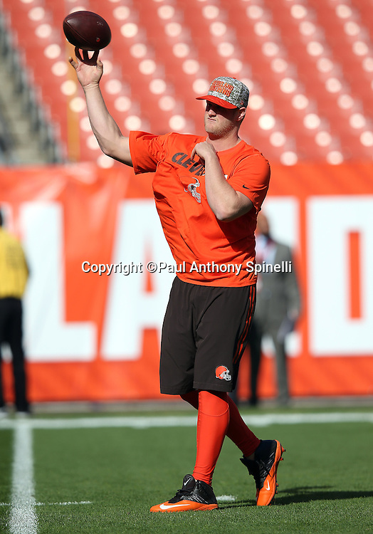 Cleveland Browns quarterback Josh McCown (13) throws a pass while warming up before the 2015 week 8 regular season NFL football game against the Arizona Cardinals on Sunday, Nov. 1, 2015 in Cleveland. The Cardinals won the game 34-20. (©Paul Anthony Spinelli)