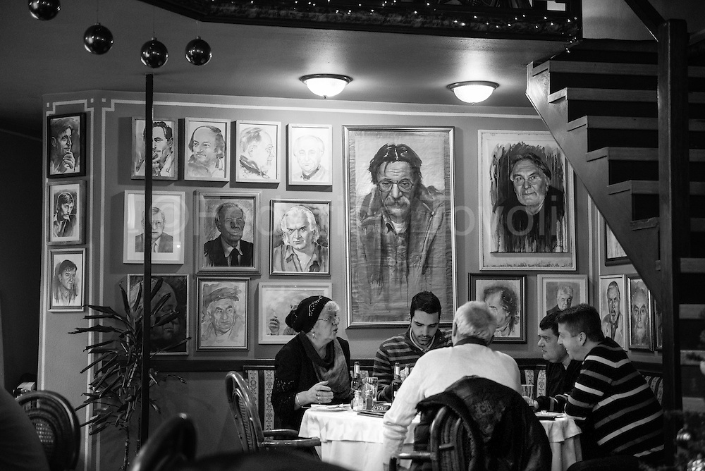 In the historic Marion restaurant  walls are filled with portraits of local artists