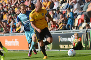 Newport County defender David Pipe (2) makes a tackle on Wycombe Wanderers striker Craig Mackail-Smith (25) 0-0 during the EFL Sky Bet League 2 match between Newport County and Wycombe Wanderers at Rodney Parade, Newport, Wales on 9 September 2017. Photo by Alan Franklin.