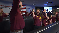 """Hand Out - The NASA InSight Team reacts after receiving confirmation that the Mars InSight lander successfully touched down on the surface of Mars, Monday, November 26, 2018 inside the Mission Support Area at NASA's Jet Propulsion Laboratory in Pasadena, California. InSight, short for Interior Exploration using Seismic Investigations, Geodesy and Heat Transport, is a Mars lander designed to study the """"inner space"""" of Mars: its crust, mantle, and core. Photo by NASA/Bill Ingalls via ABACAPRESS.COM"""