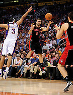 Mar. 23, 2011; Phoenix, AZ, USA; Toronto Raptors guard Jose Calderon (8) makes a pass against the Phoenix Suns forward Jared Dudley (3) at the US Airways Center. Mandatory Credit: Jennifer Stewart-US PRESSWIRE