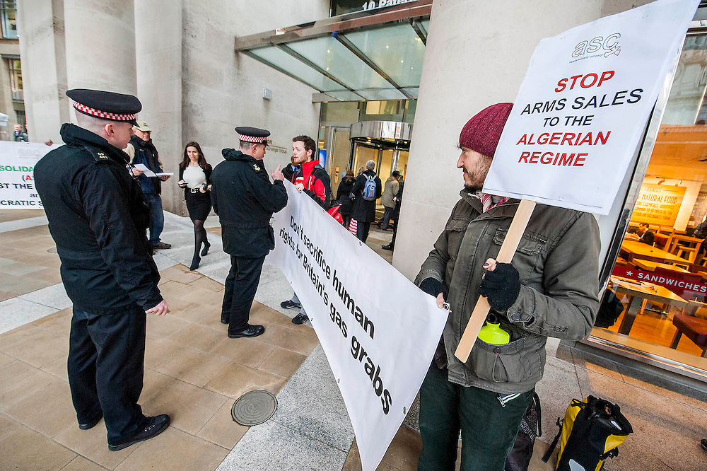 "Human rights protestors from the Algeria Solidarity Campaign (ASC) gather outside the London Stock Exchange to raise awareness about what they call 'the repressive Algerian regime' and its links with powerful multinationals such as BP who are keen on its gas reserves. Inside there is a business conference – The Algerian Investor Window – and the protestors hope to highlight issues about ""British collusion with a repressive and corrupt regime for the sake of business interests and securing fossil fuel supplies"" with the attendees. Paternoster Square, London, UK 10 Feb 2014. Guy Bell, 07771 786236, guy@gbphotos.com"