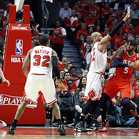 10 May 2011: Chicago Bulls forward Taj Gibson (22) defends on Atlanta Hawks power forward Josh Smith (5) during the Chicago Bulls 95-83 victory over the Atlanta Hawks, during game 5 of the Eastern Conference semi finals at the United Center, Chicago, Illinois, USA.