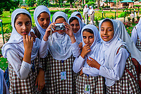 Muslim school girls taking a photo in Shalimar Bagh (a Mughal Garden), near Srinagar, Kashmir, Jammu and Kashmir State, India.