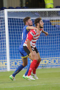 Brotherly love, Ryan Sweeney ( AFC Wim ) & Dan Sweeney (Kingstonian ) during the match between Kingstonian and AFC Wimbledon at the Cherry Red Records Stadium, Kingston, England on 30 July 2015. Photo by Stuart Butcher.
