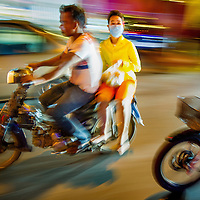 Jan 5, 2013 - Riding the streets of Phenom Penh looking for summer night life in the Cambodian capital city. Proper Kamir girls ride side saddle while cruising the streets in search of a place to see and be seen.<br /> <br /> Story Summary: Amidst the feverish pace of Phnom Penh&rsquo; city streets, a workhorse of transportation for people and goods emerges: Bicycles, motorcycles, scooters, Mopeds, motodups and Tuk Tuks roam in place of cars and trucks. Almost 90 percent of the vehicles roaming the Cambodian capital of almost 2.3 million people choose these for getting about. Congestion and environment both benefit from the small size and small engines. Business is booming in the movement of goods and and another one million annual tourists in Cambodia&rsquo;s moto culture.