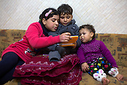 Palestinian children Sharif al-Namlah ,3, (center )and his cousins Alaa ,12 (left) and Qusay at play at the family's home  in Rafa,Gaza January 19,2015. Sharif lost part of his leg , Alaa was badly burned and Qusay's mother and father were killed  during last summer's war between Israel and the Hamas-controlled Gaza Strip. Sharif's mother lost both of her legs and his father lost one .The incident happened on August 1,2014 , one of the darkest days during the war that has been named 'Black Friday' when over 50 Palestinians were killed in the Rafa area of southern Gaza during a breakdown of a cease fire agreement during a tunnel incident between Hamas and Israeli troops .<br /> The family was fleeing on foot trying to reach a safer area when an Israeli  rocket attack hit them . Wael's 11 -year old sister and his brother Yusef and his wife were killed . (Photo by Heidi Levine/Sipa Press).