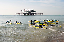 Brighton, UK. 26/11/2016, Members of the Brighton Surf Life Saving Club take part in their weekly lessons as mild weather is hitting Brighton and the South Coast. Photo Credit: Hugo Michiels