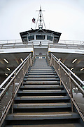 outside stairway climbs to the passenger deck of a Washington State Ferry, Steilacoom II, borrowed from Pierce County by the Washington State Department of Transportation to run on the Port Townsend - Keystone route until a new ferry is assigned to the route. Admiralty Inlet, Puget Sound, Washington, USA.