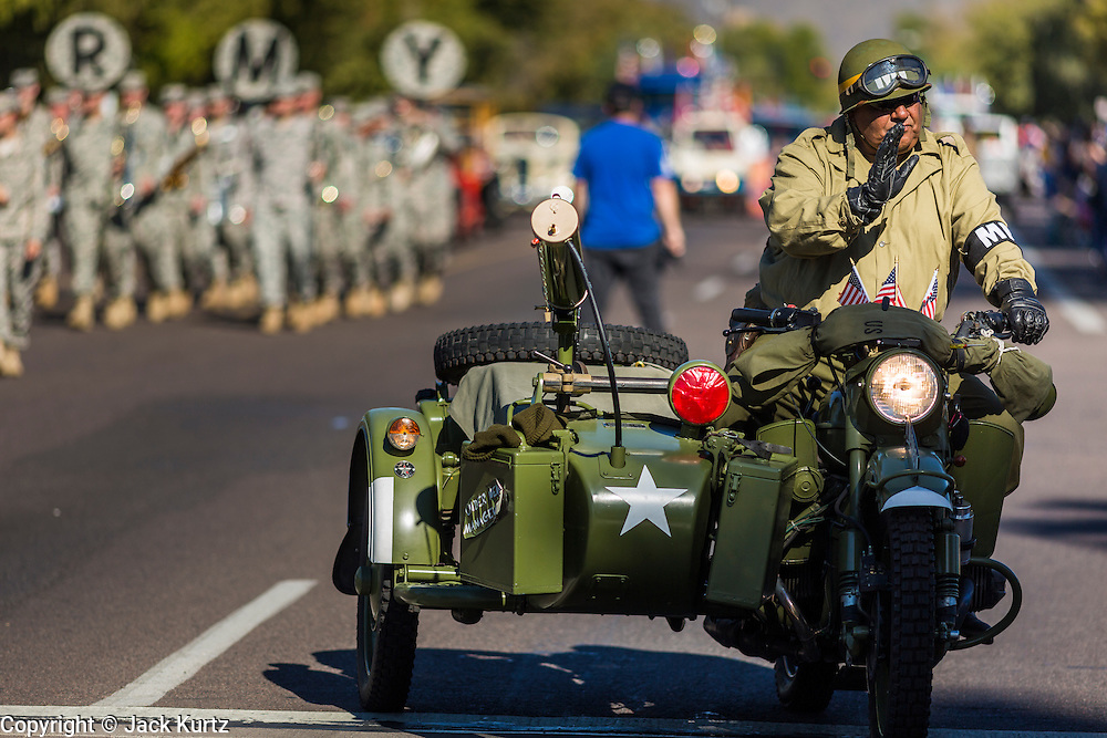 "11 NOVEMBER 2013 - PHOENIX, AZ: A men dressed as World War II veteran in the Phoenix Veterans Day Parade. The Phoenix Veterans Day Parade is one of the largest in the United States. Thousands of people line the 3.5 mile parade route and more than 85 units participate in the parade. The theme of this year's parade is ""saluting America's veterans.""    PHOTO BY JACK KURTZ"