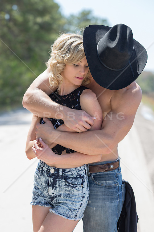 beautiful woman and a sexy cowboy together outdoors being affectionate muscular shirtless cowboy and a sexy blonde girl together outdoors