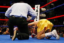 April 12, 2008; Atlantic City, NJ, USA;  Kermit Cintron (Gold w/Red) gets counted out in the 6th round of his 12 round IBF Welterweight Championship fight against Antonio Margarito at Boardwalk Hall in Atlantic City, NJ.