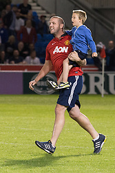 Image ©Licensed to i-Images Picture Agency. 07/08/2014. Salford, United Kingdom. Class of 92 Manchester. AJ Bell Stadium. Pitch invaders after the final whistle . Class of 92 squad play Salford City FC at the AJ Bell Stadium . Picture by i-Images