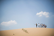 Chinese tourists take a selfie with a GoPro camera in the Gobi Desert in Inner Mongolia, China, July 27, 2014. <br /> <br /> Smartphones are an essential tool of Chinese ordinary life. Everywhere in China, people use them to take pictures to share online, to talk and chat, to play videogames, to get access to the mainstream information, to get connected one each other. In the country where the main global social media are forbidden - Facebook, Twitter and Youtube are not available  -, local social networks such as WeChat have a wide spread all over the citizens. The effect is an ordinary and apparently compulsive way to get easy access to digital technology and modern way of communication. <br /> A life through the display. Yes, We Chat.<br /> <br /> © Giorgio Perottino