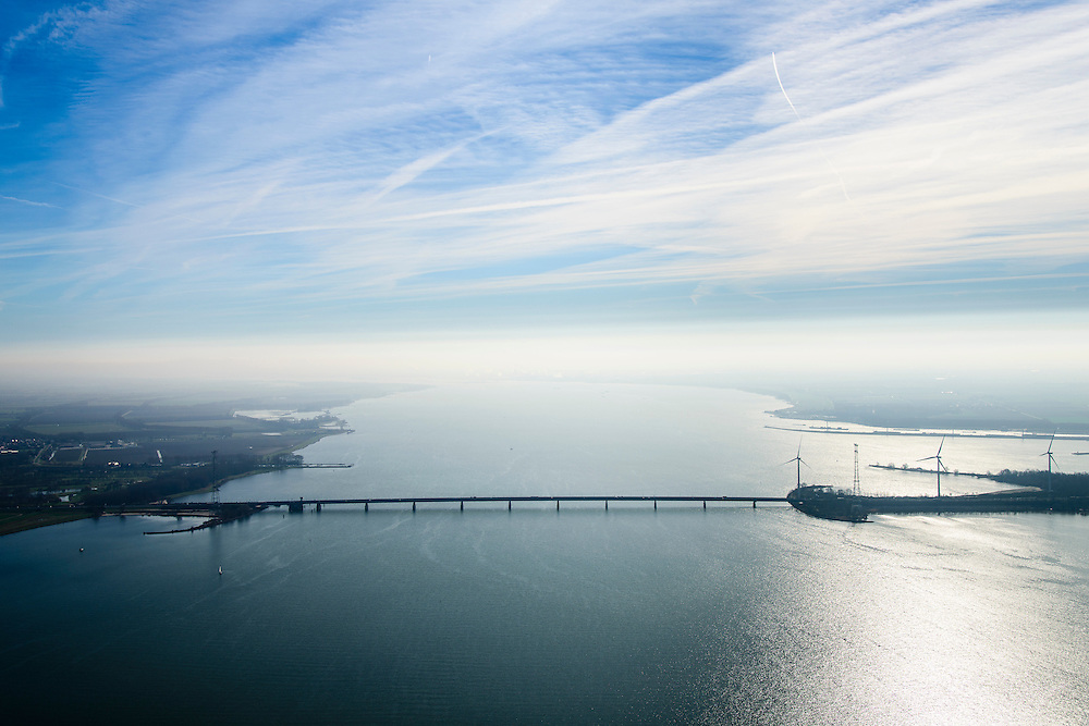 Nederland, Zuid-Holland, Harinvliet, 01-04-2016; Haringvlietbrug in tegenlicht gezien naar Hollandsch Diep. Verbinding tussen Hoeksche Waard met Goeree-Overflakkee.<br /> Bridge crossing Haringvliet estuary.<br /> <br /> luchtfoto (toeslag op standard tarieven);<br /> aerial photo (additional fee required);<br /> copyright foto/photo Siebe Swart