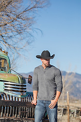 cowboy by a vintage truck